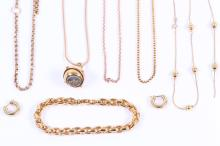 A group of  jewellery, including five 9ct gold chains, one suspending a compass pendant, a pair of 9ct gold earhoops and a bracelet, UK hallmarks (7)