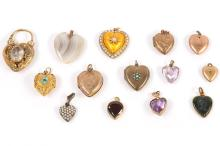 A collection of antique heart pendants, including aclasp set with hairwork, two 9 carat gold examples,hardstone examples, and few basemetal examples, twowith UK hallmarks(14)