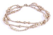 A silver bead torsade necklace, by Tiffany & Co., composed of three strands of vari-sized silver beads, UK import mark, signed T & Co., maker's case