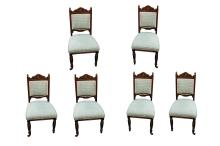 A set of six late Victorian carved oak dining chairs, late 19th Century, on ring turned tapered legs (6)