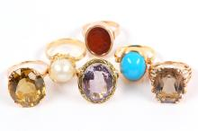 A collection ofrings, including a cultured pearl dress ring in an abstract 18 carat gold mount, a faceted amethyst dress ring, a collect-set turquoise ring, stamped 18k, an intaglio carved with Islamic script, a smoky quartz ring, and a citrine ring, stamped 14K, one ring with UK hallmark(6)