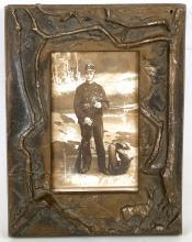 A deep cast bronze frame by H. Bader, 24 x 18.5cm