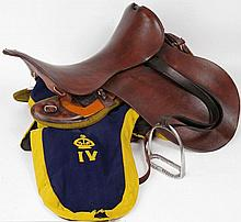 A military brown leather riding saddle, wood and