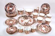 A collection of Royal Crown Derby tea ware in 'Old Imari' pattern, decorated in traditional style in red and blue enriched with gold, comprising plates, coffee cups, tea cups, saucers, a cream jug, and a sugar bowl etc (Qty).