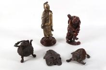 A selection of Chinese objects; a tortoiseshell circular box with articulated cormorants to lid, an antimony ashtray with turtles, a small bronze decorative teapot and a pair of deeply carved framed bamboo reliefs, with other items (8).