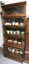 An oak Globe Wernicke five section bookcase, of typical form, with glazed doors and drawer to base.