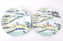 A pair of 19th Century Chinese famille verte landscape plates, with Kangxi marks to reverse.