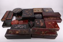 A mixed collection of twenty early 20th Century, Oriental, Japanese and Chinese lacquered novelty boxes. All decorated with flora and fauna in Oriental landscape view (20).