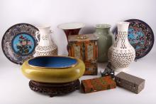Two Chinese white glazed vases with pierced decoration, an oxblood glazed Gu vase, a celadon glazed vase with incised decoration, two Japanese cloisonne enamel dishes, a wooden jewellery box with inlaid carved jade panels, a Chinese yellow cloisonne enamel washer, a bronze figure of a boy riding a buffalo, an oval wooden plaque with a lady's figure carved in it, and two jade cups, 4cm - 35cm (12).