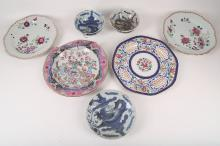 A pair of 18th Century Chinese porcelain famille rose plates decorated with flowers, two other plates and three blue and white bowls (6).