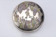 AN ENAMELLED SILVER BOX AND COVER.