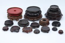 A COLLECTION OF CARVED WOOD STANDS.