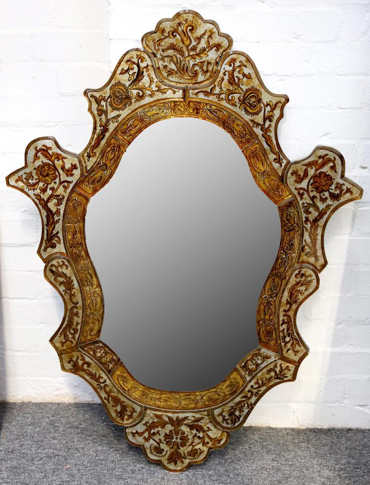 A reproduction Venetian style wall mirror.