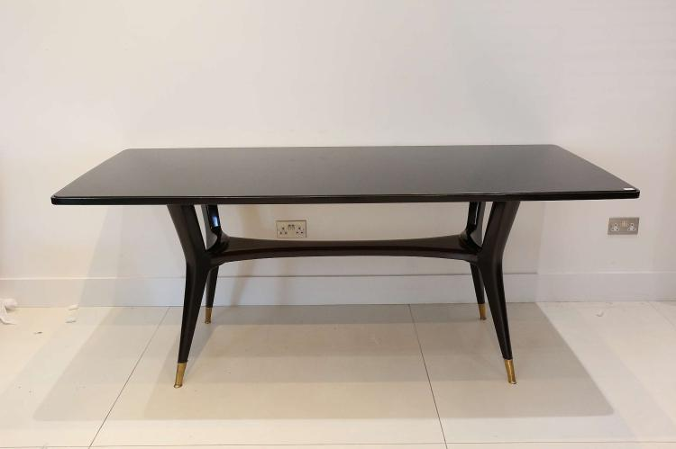 A 1950s ITALIAN DINING TABLE, with black glass inset top, on