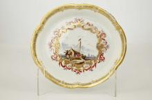 A FINE MEISSEN PORCELAIN TEAPOT STAND, circa 1740,the centre finely painted with a Kauffahrtei scene depicting figures on a boat with buildings in the distance, within an elaborate gilt scrollwork and Böttger lustre cartouche with iron red and purple detailing, the shaped rim with a formal gilt border, 15.5cm wide, gilt no. 48. and impressed numeral 23 to base
