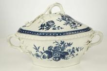 A WORCESTER PORCELAIN SOUP TUREEN AND COVER, circa 1770, of lobed quatreform shape with gadroon moulded rims, the applied twig handles with oak leaf and acorn terminals, printed in blue with various botanical prints, the interior with the 'Primula' print, 18.5cm high, crescent mark in blue   FOOTNOTES:  Worcester pieces with applied acorns are particularly rare. For a virtually identical tureen see that in the Zorensky Collection, sold by Bonhams, 16 March 2004, lot 369.