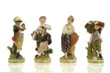 A SET OF FOUR DERBY PORCELAIN FIGURES REPRESENTING THE 'FRENCH SEASONS', circa 1810, probably by Pierre Stephan, each figure modelled as a standing boy or girl wearing richly decorated period clothing, 'Spring' holding a garland of flowers, 'Summer' carrying a basket of fruit, 'Autumn' with a stook of corn and flowers, and 'Winter' carrying faggots over his shoulder, each before a tree stump, raised on naturalistic circular bases encrusted with flowers and with gilt-line borders, 16cm-18cm high, each with incised model no. 123 (4)   FOOTNOTES:  These models probably have their origins in Tornai, where N.F.J Gouron modelled sets of eight figures representing the Seasons, four of which are thought to have been prototypes for the Derby versions. The Derby versions are traditionally attributed to Pierre Stephan, who worked at Tornai before moving to Derby to work for Duesbury around 1770. Whilst it has been suggested that the Derby versions were derived from designs by François Boucher, the evidence for this is purely stylistic.