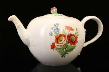 A MEISSEN MARCOLINI PERIOD PORCELAIN TEAPOT AND COVER, circa 1800, of globular form, painted to both sides with strays of colourful flowers, the cover with further sprigs of flowers and a pink bud finial, the twig handle and spout issuing moulded flowers and leaves, 13.5cm high, crossed swords and star mark in underglaze-blue, incised and impressed numerals