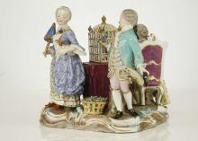 A MEISSEN PORCELAIN FIGURE GROUP ALLEGORICAL OF 'VIRTUE', late 19th century, modelled with a bird cage on a covered table to the centre, a young gentleman seated upon a high-backed rococo chair playing a flute to one side, an elegant lady holding a parasol and a small dog to the other, beside whom stands a gentleman offering her a bouquet of flowers, a basket of flowers to his feet, on a rococo scroll base heightened in gold, 15.5cm high, crossed-swords mark in underglaze blue, incised model no. 2897 (restuck)   FOOTNOTES: A very similar figure was sold by Christie's, 10 January 2007, lot 1129, and an 18th century version by Bonhams, 9 December 2009, lot 118.