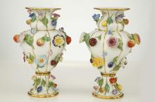 A GOOD PAIR OF MEISSEN PORCELAIN FRUIT AND FLOWER ENCRUSTED VASES, late 19th century, both of inverted pear-shaped form with pedestal foot and spreading rim, the ozier-moulded ground applied all-over with colourful flowers and fruit, including roses, primulas, apples, strawberries, plums, lemons and pears, with gilt-line detailing, 19.5cm high, crossed swords marks in underglaze blue, painter's numeral 13 in puce, incised model no. 1927, impressed numerals (2)