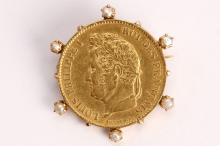 A coin brooch  The 40 franc coin, dated 1834 for Louis Philippe I, the collet-setting accented by half pearls, length 3.3cm