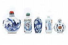 FIVE BLUE AND WHITE SNUFF BOTTLES.   Qing Dynasty.   Three decorated with figurative scenes, one with stylised shou characters, another with prunus flowers, 6 - 10cm H. (5)   Provenance: Collection of Bernard Buckman (1910 – 1991).   ? ???????