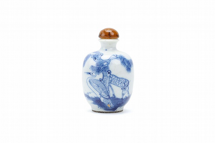 A BLUE AND WHITE 'DEER AND CRANE' SNUFF BOTTLE.   Qing Dynasty.   The two animals below a pine tree, stopper, 6.5cm H.   Provenance: Collection of Bernard Buckman (1910 – 1991).   ? ???????????