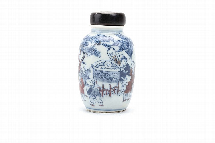 A CHINESE UNDERGLAZE COPPER RED DECORATED BLUE AND WHITE 'HUNDRED BOYS' SNUFF BOTTLE. Qing Dynasty. The body decorated with a continuous scene of boys frolicking in a garden, the interior of the rim decorated with a band of bats, the base painted with a boat, horn stopper, 7cm H. Provenance: Collection of Bernard Buckman (1910 – 1991). ? ???????????