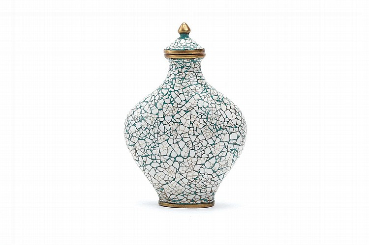 A CHINESE 'MOSAIC PATTERN' ENAMELLED SNUFF BOTTLE.   Qing Dynasty.   With white fragments of enamel set in with a turquoise green ground, original matching stopper, 7cm H.   Provenance: Collection of Bernard Buckman (1910 – 1991).   ? ?????????