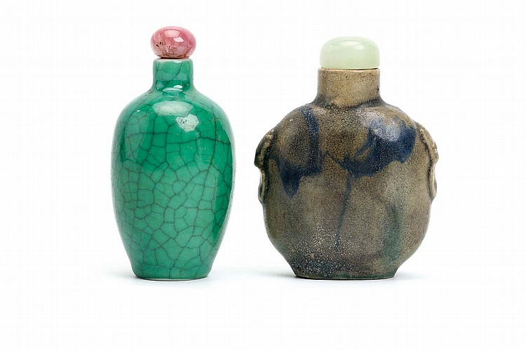 A CHINESE APPLE GREEN AND STREAKY BLUE-GLAZED SNUFF BOTTLE.   Qing Dynasty.   7.5cm H. (2)   Provenance: Collection of Bernard Buckman (1910 – 1991).   ? ??????????????