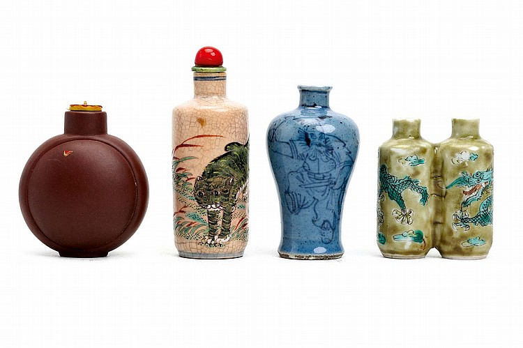 FOUR CHINESE PORCELAIN SNUFF BOTTLES.   19th / 20th Century.   Comprising a cat snuff bottle, a 'Zhong Kui' meiping-form bottle, a double dragon snuff bottle and a yixing zesha bottle, 6 - 8cm H. (4)   Provenance: Collection of Bernard Buckman (1910 – 1991).   19-20?? ????????