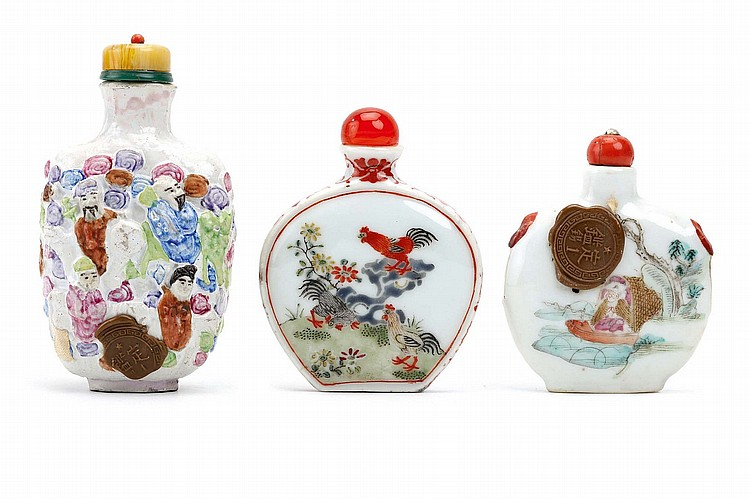 THREE CHINESE FAMILLE ROSE SNUFF BOTTLE.   Comprising a moulded figurative snuff bottle, Qianlong nianzhi mark, a 'cockerels' snuff bottle, Qianlong nianzhi mark, and a 'boating figure' snuff bottle, Yongzheng nianzhi mark, 9cm H. (3)   Provenance: Collection of Bernard Buckman (1910 – 1991).   ???????