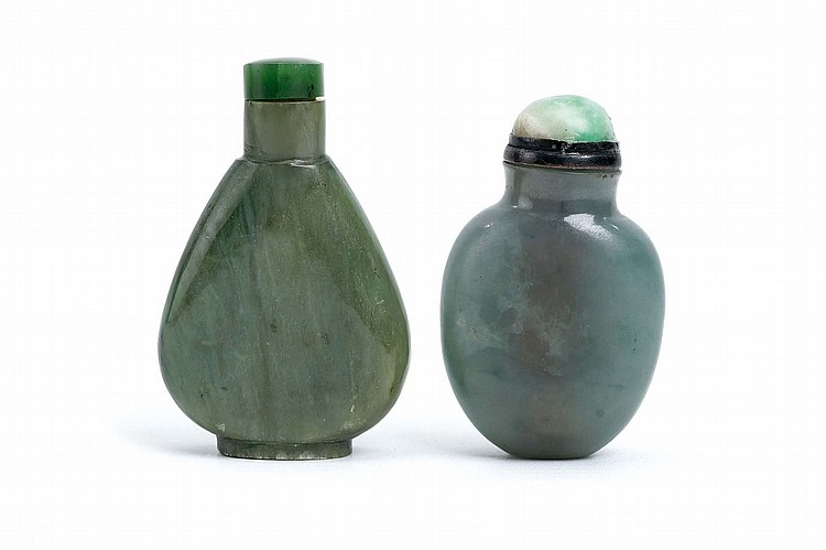 TWO CHINESE JADE SNUFF BOTTLES.   Qing Dynasty.   One of ovoid form, stopper, 5.5cm, the other of compressed pear-shaped form, 6.5cm H. (2)   Provenance: Collection of Bernard Buckman (1910 – 1991).   ? ???????