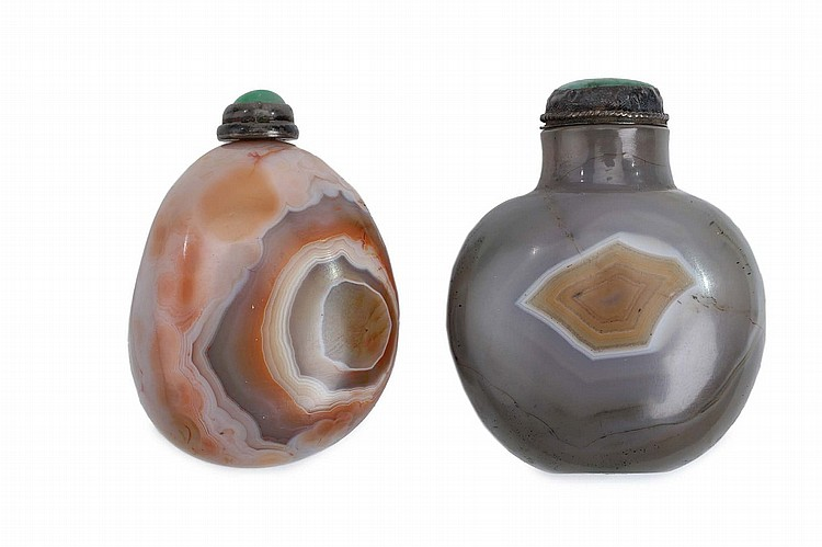 TWO CHINESE BANDED AGATE SNUFF BOTTLES.   Qing Dynasty.   One formed as a pebble, 5 cm, the other of compressed ovoid form, 5.5cm H, stoppers. (2)   Provenance: Collection of Bernard Buckman (1910 – 1991).   ? ???????