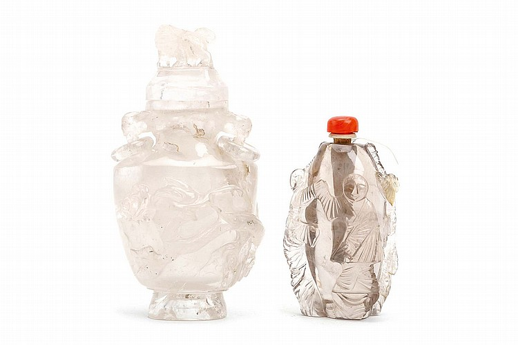 A CHINESE ROCK CRYSTAL VASE AND COVER TOGETHER WITH A 'BOYS' SNUFF BOTTLE. Late Qing Dynasty. The vase incised to the body, with handles suspending rings to the shoulders, the cover surmounted by a Buddhist lion dog, 15cm H, the other snuff bottle with clambering boys carved in relief around the body, 10cm H. (2) Provenance: Collection of Bernard Buckman (1910 – 1991). ??? ????????????
