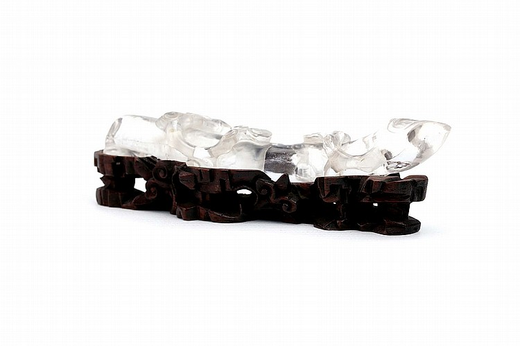 A CHINESE ROCK CRYSTAL 'LINGZHI BRANCH' WRIST REST. Qing Dynasty. Naturalistically carved with lingzhi spray issuing from a central branch, the carved and pierced wood stand carved as rockwork covered in lingzhi spray, 12cm long. Provenance: Collection of Bernard Buckman (1910 – 1991). ? ???????