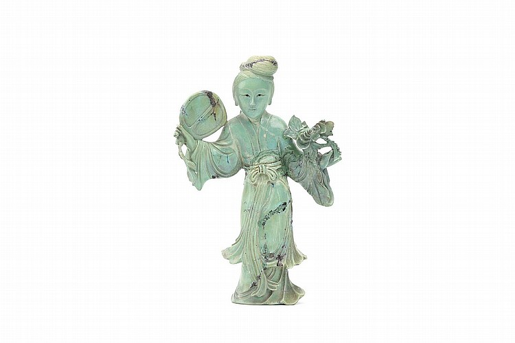 A CHINESE TURQUOISE CARVING OF A LADY.   19th / 20th Century.   Standing in a long flowing dress, a fan in the right hand, a floral spray in the left, 14cm H.   Provenance: Collection of Bernard Buckman (1910 – 1991).   19-20?? ???????