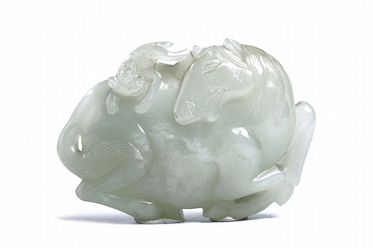 A CHINESE JADE 'HORSE AND MONKEY' BELT HOOK. Qing Dynasty, 18th Century. Carved in relief with a monkey clambering on the rear haunch of the horse, the hook on the reverse side carved as a chi dragon's head, 5.5 x 8cm. Provenance: Collection of