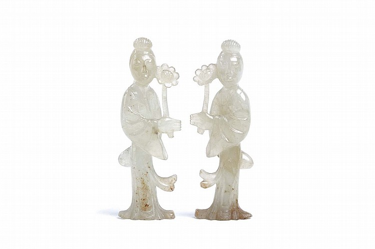 TWO CHINESE AGATE CARVINGS OF LADIES. Qing Dynasty. Each carved in the round in long flowing robes, holding a flower, 7.5cm H. (2) Provenance: Collection of Bernard Buckman (1910 – 1991). ? ???????