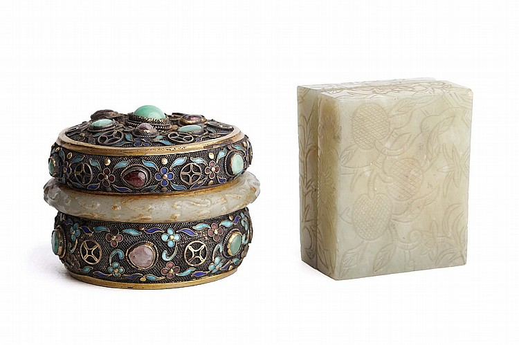 A CHINESE RECTANGULAR JADE BOX AND COVER, TOGETHER WITH A CIRUCLAR ENAMELLED SILVER AND JADE BOX AND COVER.   19th / 20th Century.   The jade box incised with fruit, the enamelled circular box inlaid with jadeite and enclosed by a jade band, 7cm long. (2)   Provenance: Collection of Bernard Buckman (1910 – 1991).   19-20?? ?????????????