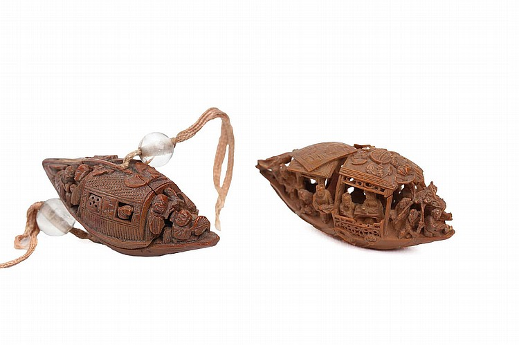 TWO CHINESE FINELY CARVED OLIVE PIT 'PLEASURE BOATS'.    Qing Dynasty.   4.5cm long. (2)   Provenance: Collection of Bernard Buckman (1910 – 1991).   ? ???????