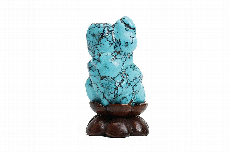 A CHINESE TURQUOISE MINIATURE SCHOLAR'S ROCK.   Qing Dynasty.   Carved wood stand, 6cm H. (3)   Provenance: Collection of Bernard Buckman (1910 – 1991).   ? ???????