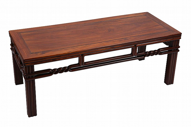 A CHINESE SUANZHIMU LOW TABLE.   19th / 20th Century.   The plain top panel enclosed by a square frame with triple moulded legs and aprons, the two stretchers with a rope twist design that connects to the lower apron section, 40 x 107 x 45cm.   Provenance: Collection of Bernard Buckman (1910 – 1991).   19/20?? ?????