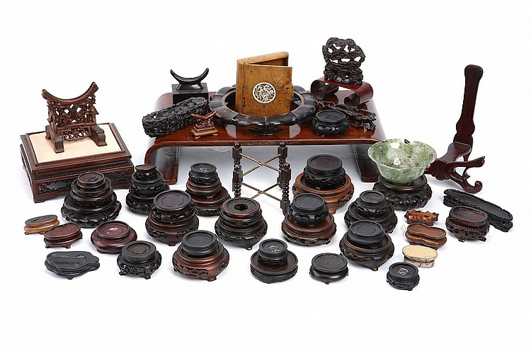 A COLLECTION OF WOOD STANDS.   The largest 8cm H. (Qty)   Provenance: Collection of Bernard Buckman (1910 – 1991).   ?????