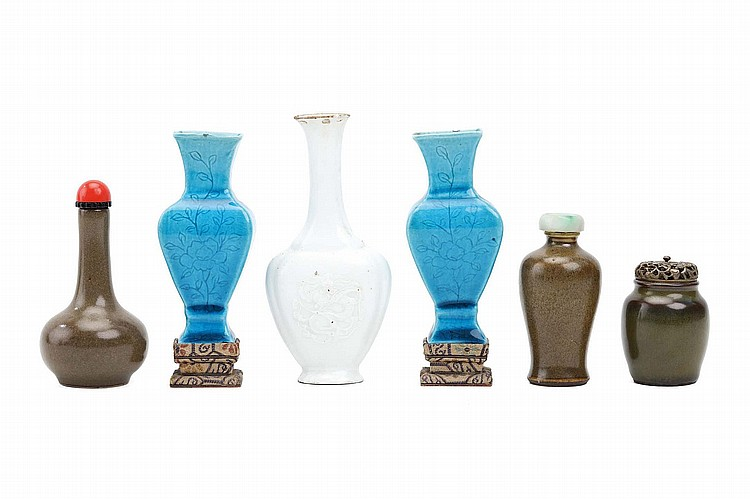 THREE CHINESE MINIATURE TEA-DUST-GLAZED VESSELS, TOGETHER WITH TWO TURQUOISE VASES AND WHITE-GLAZED VASE. Qing Dynasty. The turquoise vases of rectangular baluster form with incised floral patterns, the white glazed compressed quadra-lobed vase with moulded dragons on either side, 5-10.5cm H. (6) Provenance: Collection of Bernard Buckman (1910 – 1991). ? ??????????????????