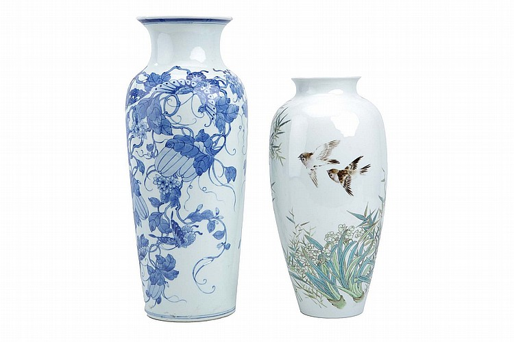 TWO DOCUMENTARY CHINESE VASES. 1955. One decorated with a bird and flowers in famille rose enamels, the other in blue and white with butterflies among melons borne on scrolling stems, dated 1955 to the base, 36 / 46cm H. (2) Provenance: Collection of Bernard Buckman (1910 – 1991). ????????????