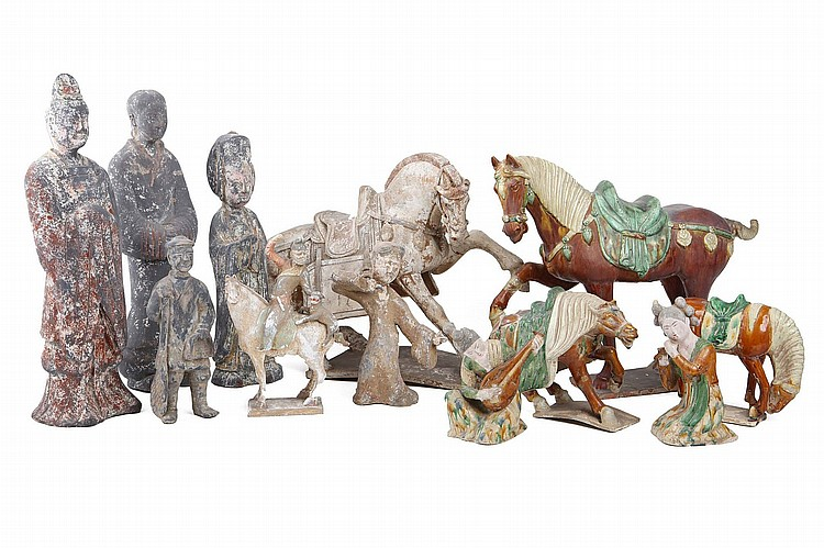 A COLLECTION OF CHINESE POTTERY FIGURES AND ANIMALS. Han Dynasty, and later. Comprising three sancai-glazed horses, and two musicians, a dancing figure, a figure, two horses, and four figures, the largest 57cm H. (12) Provenance: Collection of Bernard Buckman (1910 – 1991). ???? ???????