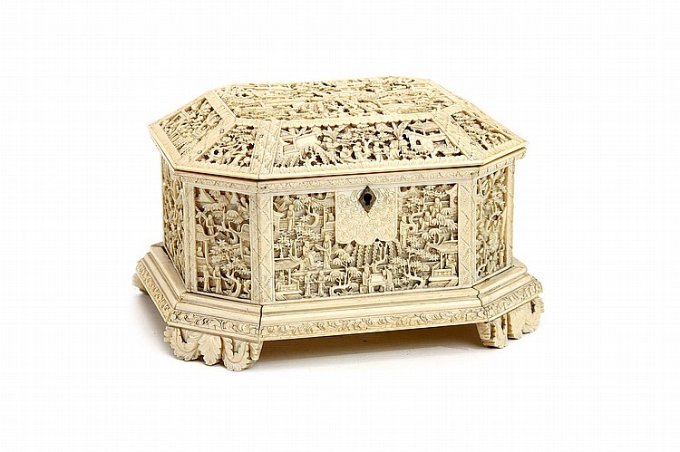 A CHINESE CANTON CARVED IVORY CHEST. Qing Dynasty. Of octagonal form with a canted hinged cover, on a stepped base supported on four scrolling-leaf-form feet, each face of the body and cover deeply incised with figures in a garden landscape, 13 x 20 x 18cm. ? ??????