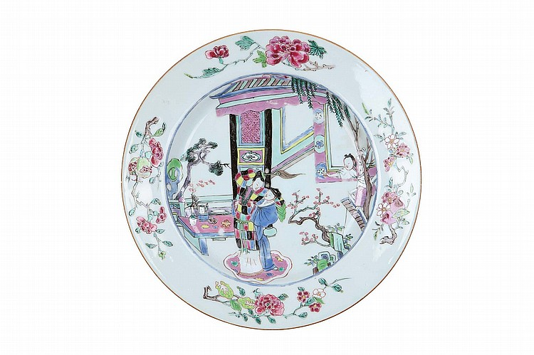 A CHINESE FAMILLE ROSE FIGURATIVE DISH. Qing Dynasty, circa 1740. Brightly decorated with lovers on a garden veranda, 22.5cm diameter. ? ?1740? ????????