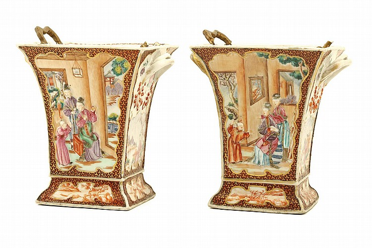 A PAIR OF CHINESE FAMILLE ROSE BOUGH POTS AND COVERS.   Qing Dynasty.   The sides each decorated with interior scenes with figures moulded in shallow relief, enamelled and gilded, 20cm H. (2)   ? ???????????